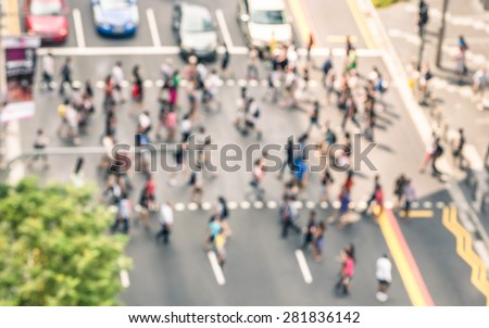 Blurred defocused abstract background of people walking on the street in Orchard Road in Singapore - Crowded city center during rush hour in urban business area zebra crossing - View from building top - stock photo