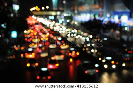 Blurred Defocused Lights of Heavy Evening Rush Hour Traffic on a City Road at Night - stock photo