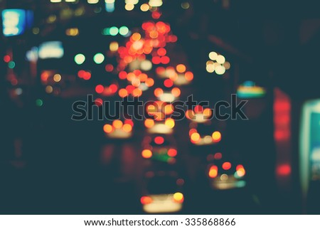 Blurred Defocused Multi Color Lights. Traffic in a City Streets. Toned in Dark Pastel Colors. Abstract Background - stock photo