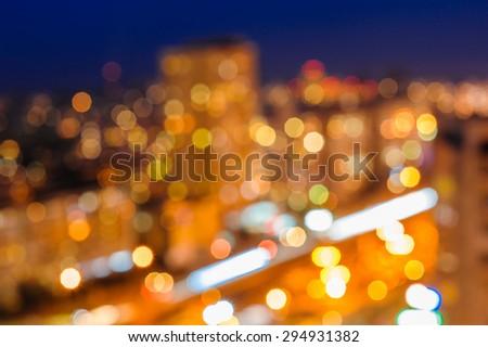 Blurred defocused night lights in city - stock photo