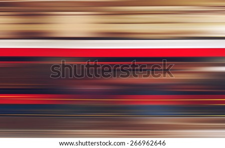 Blurred defocused subway train in motion as abstract urban background, speed and living fast in modern urban cities and environment. - stock photo