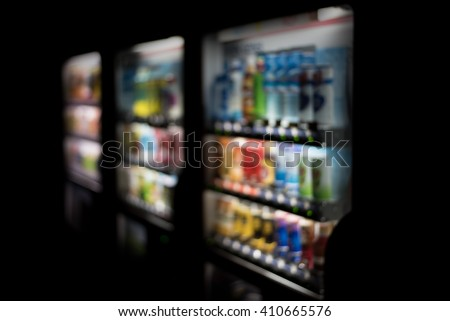 Blurred / Defocussed abstract background of colorful soft drinks / juice bottles vending machines, taken in Japan - stock photo