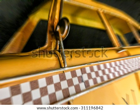 Blurred detail of checkered taxi. - stock photo