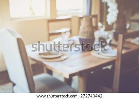 Blurred Dining Room Table with Retro Instagram Style Filter - stock photo