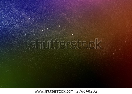 Blurred dot and bokeh from technic spray water front black background.Imagine to univese and used gradient tool for color style. - stock photo
