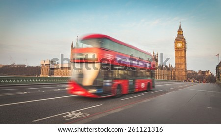 Blurred double decker red bus with Westminster and Big Ben on background, long exposure technique with focus on background - stock photo