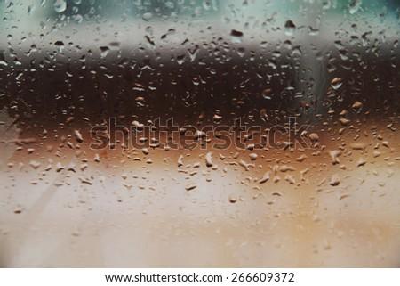 Blurred drops background.Rainy glass. - stock photo