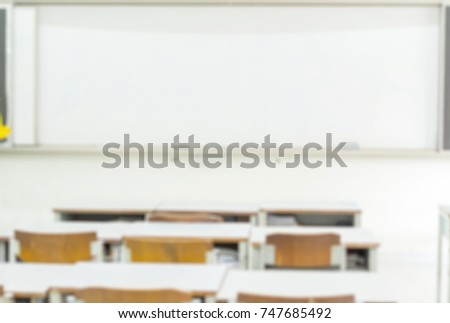 college classroom whiteboard. blurred education and school classroom background with wooden chairs, desks white board. college whiteboard u