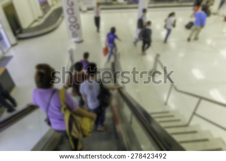 Blurred escalators connect the passenger gangway. - stock photo