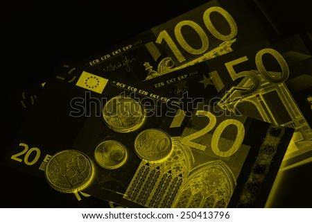 blurred Euro (EUR) banknotes and coins money useful as a background or money concept,fitter color photo.  - stock photo