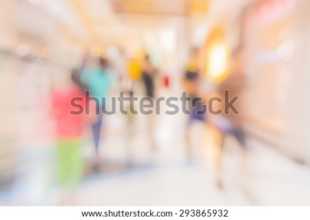 blurred fast speed  image of shopping mall and people. - stock photo