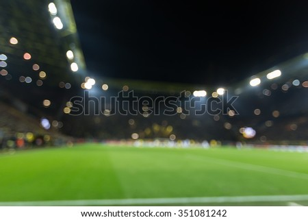Blurred field with lights and full of spectators at the stadium one step at a sporting event - stock photo
