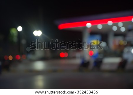 Blurred Gas station at night - stock photo