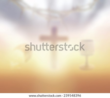 Blurred glass of wine and Loaf of bread with crown of thorns and the cross on a sunset in eucharist. - stock photo
