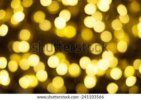 Blurred golden light spark bokeh background - stock photo