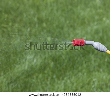 Blurred grass background, sprinkle in the center. - stock photo