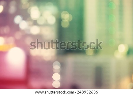 Blurred green and pink urban building background scene - stock photo
