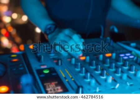 Blurred hand of dj on turntable,music background
