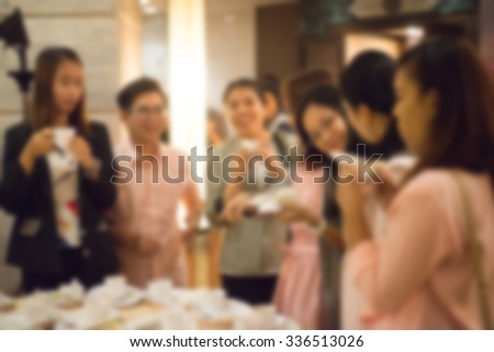 Blurred Happy work team during break time in office - stock photo