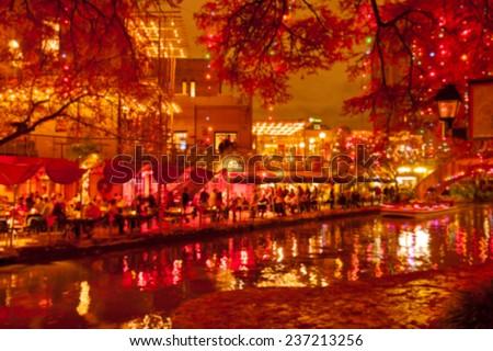 Blurred holiday background. River walk  in San Antonio city at night in Christmas season, Texas, USA - stock photo
