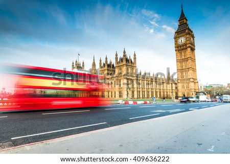 Blurred iconic bus and Big Ben in London, sunrise at Westminster Bridge - stock photo