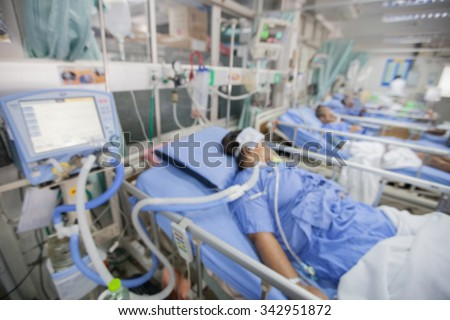 Blurred ICU room in a hospital with medical equipments and patient. - stock photo