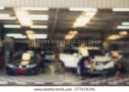 blurred image : car washing cleaning with water at service station - stock photo