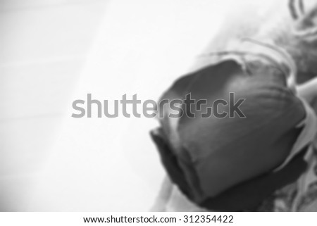Blurred image for background of rose with copy space for message, black and white