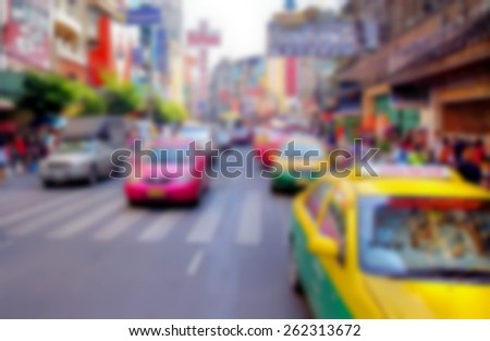 blurred image from a street in a big city filled with cars and cabs  - stock photo