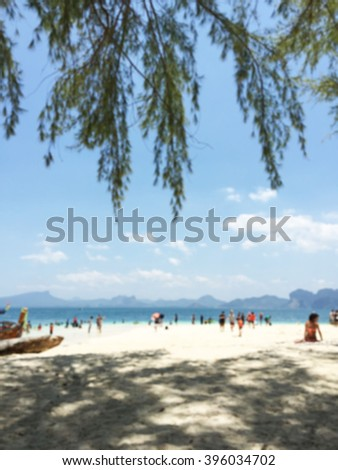 BLURRED IMAGE OF A BEACH ON A SUNNY DAY - stock photo