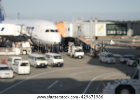 Blurred image of aircraft waiting for luggage loading at the airport terminal for transportation background - stock photo
