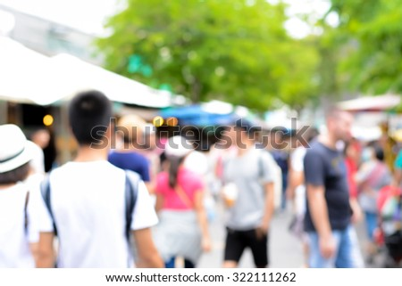 Blurred image of crowd walking in outdoor market