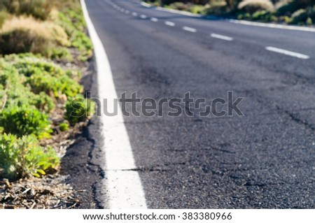 Blurred image of desert road, diminishing perspective - stock photo