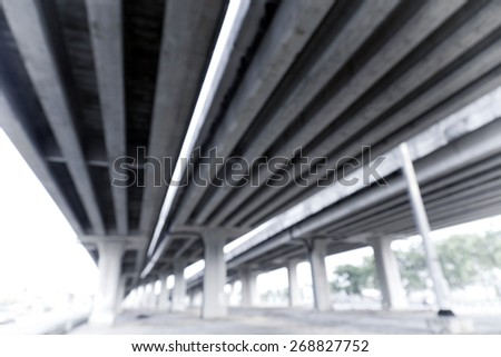 Blurred image of elevated traffic highway - stock photo