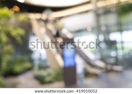Blurred image of escalator for background use - stock photo