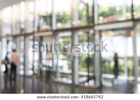 Blurred image of Glass Elevator for background use - stock photo