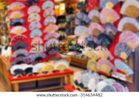 Blurred image of japanese folding fans at a shop - stock photo