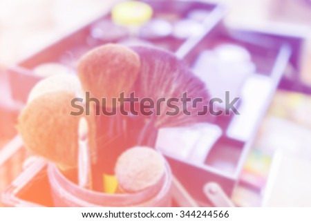Blurred image of makeup brushes in a makeup artist case.Colorful tone - stock photo