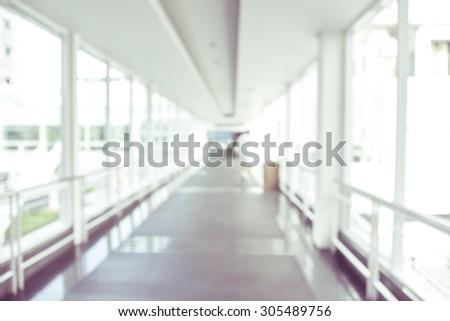 blurred image of modern hospital - corridor hallway - stock photo