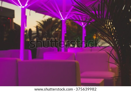 Blurred image of night club outdoor terrace, nightlife concept - stock photo