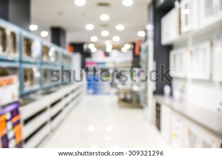 blurred image of office supply shelf in shop - blur background concept - stock photo