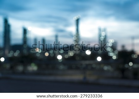 blurred image of oil refinery plant at twilight  - stock photo