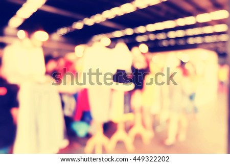 blurred image of people in shopping mall .