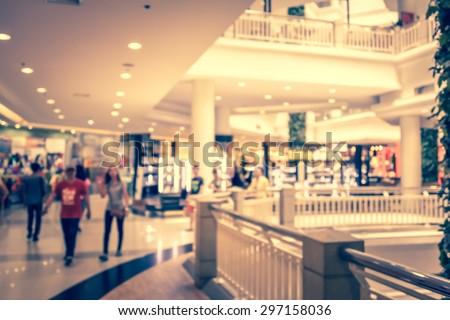 blurred image of people in shopping mall vintage style - stock photo