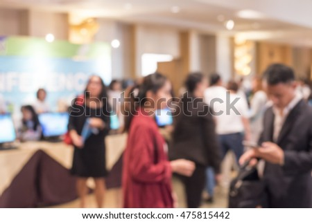Blurred image of people in the hall