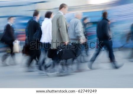 Blurred image of people rushing to work in the morning - stock photo