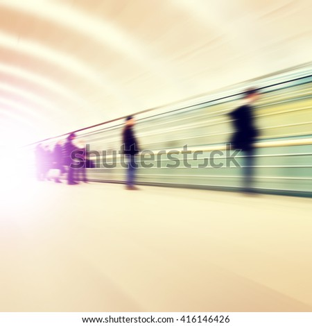 Blurred image of people waiting at subway station. - stock photo