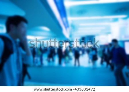Blurred image of people with blue color filler