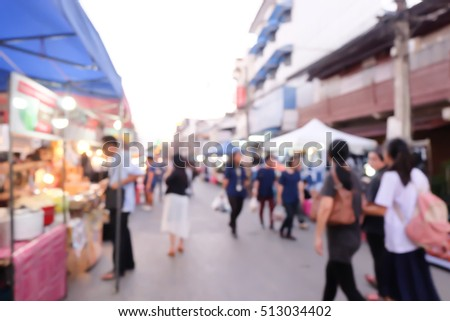 blurred image of people working street in Chiangmai.