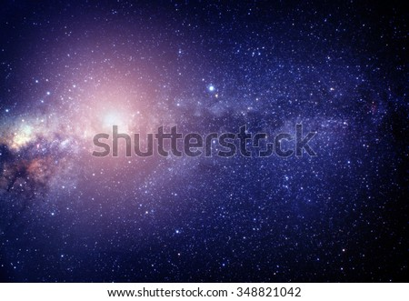 blurred image of pink stars in the galaxy. Some elements of this image furnished by NASA - stock photo